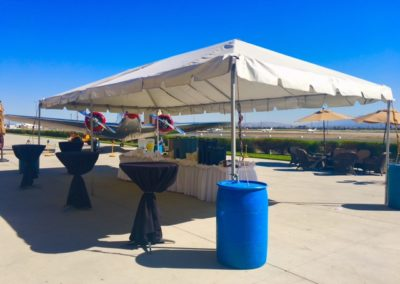 indoor and outdoor area at plane hangar for a corporate event